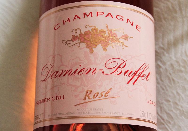 bouteille de champagne premier cru brut rose damien buffet a sacy